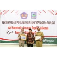 Pemerintah Kabupaten Dompu Terima Piagam Penghargaan Dan Plakat WTP Yang Ke 6